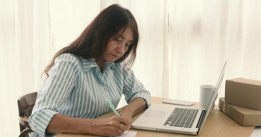 Adult businesswoman working at table Stock Video Footage