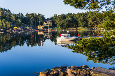 A fishing motor boat or a small yacht on the Scandinavian coast Photo