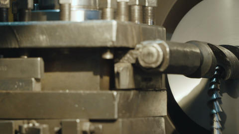 Milling Machine Produces Metal Detail on Factory Live Action