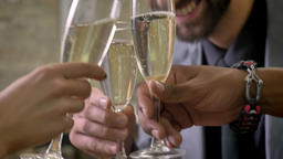 Three hands of business workers clink glasses with champagne in office ビデオ