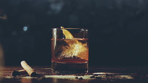Alcohol cocktail with ice cubes on a bar Footage