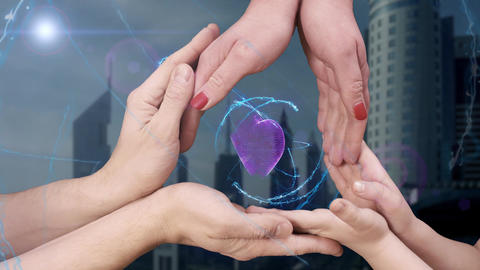 Men's, women's and children's hands show a hologram 3D heart ビデオ