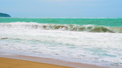sea wave on a sandy beach on a sunny day Footage
