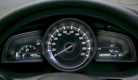 Close up of car dashboard and odometer Photo