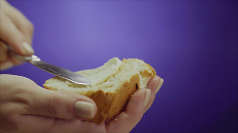 Butter is spread on bread. White butter is spread over fresh bread Footage