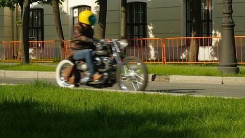 man riding a chopper on a street ビデオ