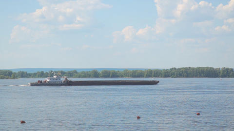 A loaded barge sails along the Volga River Footage