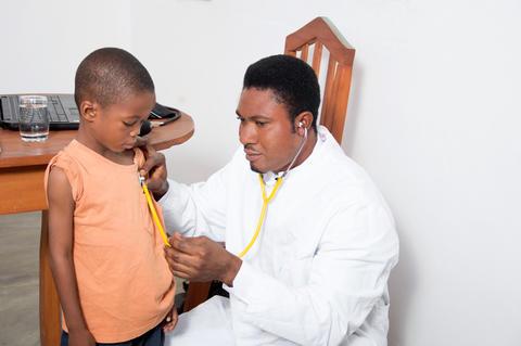 health professional examining a child フォト