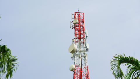 Communication tower, cellphone tower in the jungle in the mountains. Aerial view Live Action
