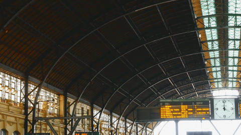 tracking shot on wrought iron roof in the north train station in Valencia, spain GIF