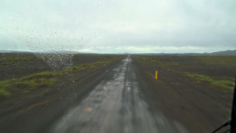 Fast off road ride in buss in rainy Iceland nature Footage