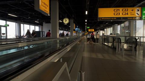 People with suitcases walking to departure hall at airport terminal, traveling Footage