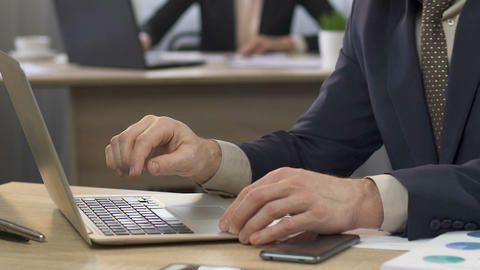 Businessman opening his laptop and answering e-mail, business correspondence Live Action