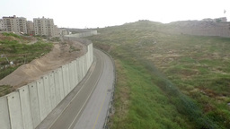 Flying close to separation wall in Jerusalem ビデオ
