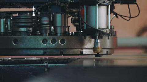 Close up automated machine manufacturing GIF