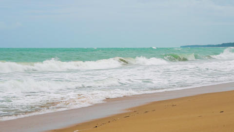 tropical beach on the island, waves are slowly breaking about the sand, tourism Footage
