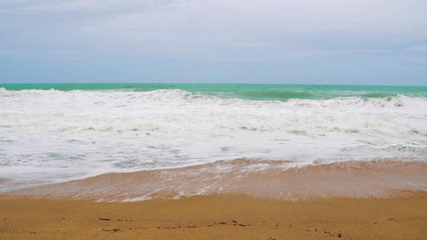 waves beat against the sandy beach in slow motion, the tropical seaside Footage