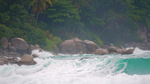 sea waves on a tropical island in front of a storm. Slow motion GIF