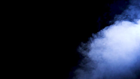 Slow motion blue smoke rising from bellow Footage