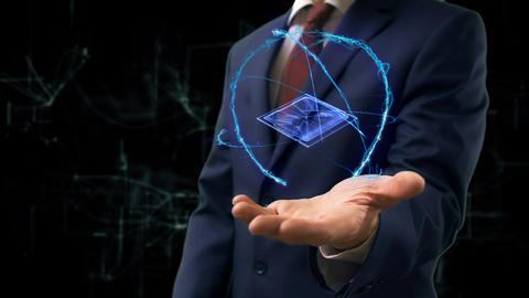 Businessman shows concept hologram 3d CPU on his hand ビデオ