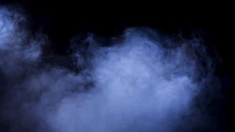 Slow motion smoke rising from bellow on black background Footage