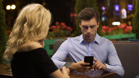 Married couple paying no attention to each other scrolling pages on smartphones Footage