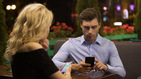 Woman trying to attract attention of her boyfriend who actively working on phone Footage