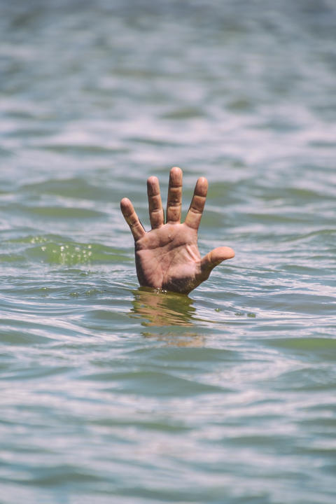 gesture for the help of a drowning man Photo