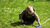 Young Boy Playing With Measuring Tape In The Backyard 02 stock footage
