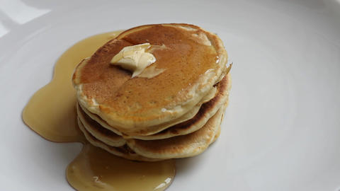 Pouring maple syrup on pancakes Stock Video Footage