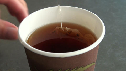 A tea bag in hot water Stock Video Footage