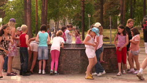 Children at the fountain Stock Video Footage