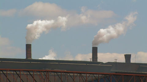 Smoking Chimneys at a Factory Footage