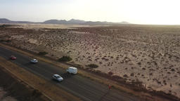 road with car in the desert ビデオ
