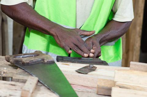 Carpenter in his workshop フォト