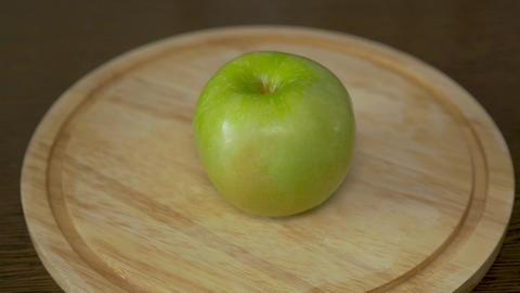 Men's hands cut an apple. Close-up, slow motion Live Action