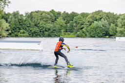 Duisburg / Germany - July 18 2018 : Boy having fun with waterski on the lake Photo