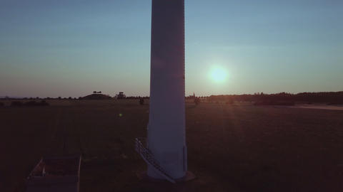 Wind turbine close up in front of the setting sun Wind Power ビデオ