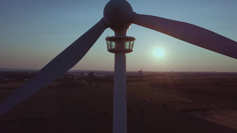 Wind turbine close up in front of the setting sun Wind Power Footage