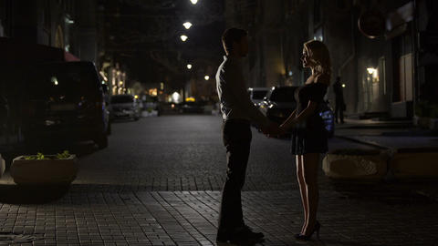Two loving people kissing tenderly in night street, love in big city, dating Footage