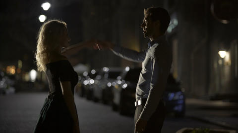 Loving man and woman dancing in night street and enjoying perfect date, romance Footage