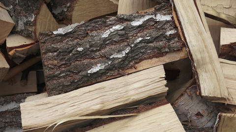 Wood made from birch (cut version). Pile of chopped fire wood prepared for GIF