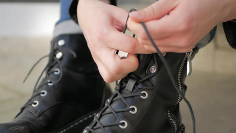 Tying black leather Shoes boots ビデオ
