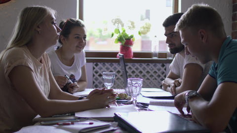Group of students preparing together to exam in university in the cafe Footage