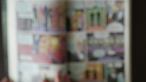 Reading comic book - top-view blurry defocused concept video Footage