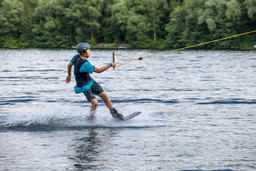 Duisburg / Germany - July 18 2018 : Boy having fun with waterski on the lake フォト