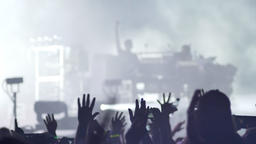 Footage of crowd raising hands at rock concert Footage