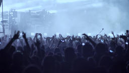 Crowd jumping at rock concert at night Footage