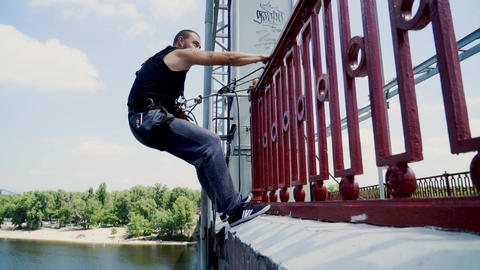 Guy on the bridge with the insurance Live Action