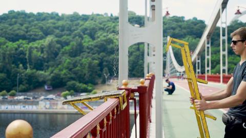 Jumper puts the ladder on the bridge Live Action